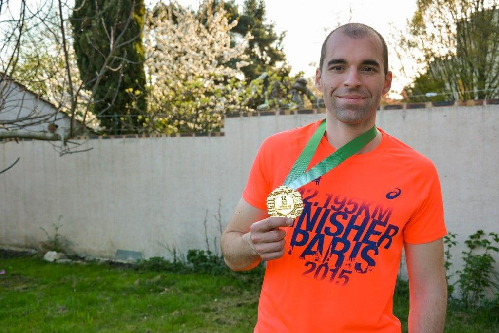 Ludo avec la médaille du marathon de Paris